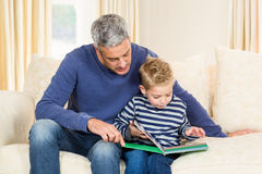 Father and son reading book Stock Photos