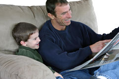 Father and Son Reading Paper Stock Photos