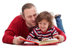 Father and son reading. A story-book - isolated Royalty Free Stock Photo