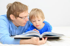 Father and son reading together Royalty Free Stock Photos
