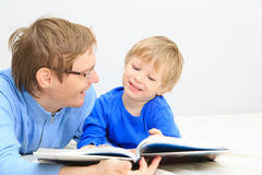 Father and son reading together Stock Images