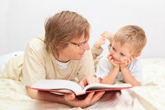Father and son reading together Stock Photos