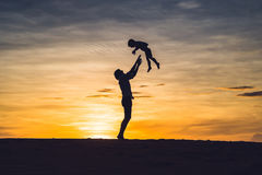 Father and son at the red desert at dawn. Traveling with children concept royalty free stock photo