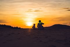 Father and son at the red desert at dawn. Traveling with children concept royalty free stock photos
