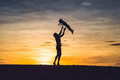 Father and son at the red desert at dawn. Traveling with children concept stock photo