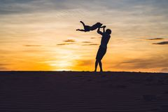 Father and son at the red desert at dawn. Traveling with childre Stock Photo