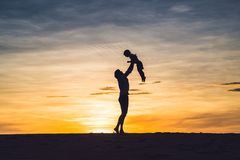 Father and son at the red desert at dawn. Traveling with children concept royalty free stock image