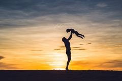 Father and son at the red desert at dawn. Traveling with childre Stock Photography