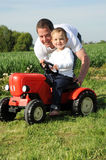 Father and son with red tractor Stock Photography