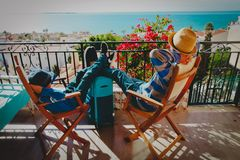 Father and son relax on balcony terrace with suitcase, travel concept. Father and son relax on balcony terrace with suitcase, family travel concept royalty free stock photography