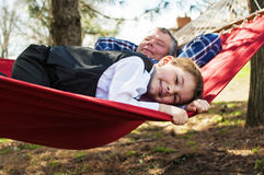 Father and son relax in hammock Royalty Free Stock Photo