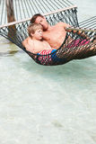 Father And Son Relaxing In Beach Hammock Stock Images