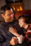 Father And Son Relaxing With Hot Drink Royalty Free Stock Photos