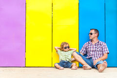 Father and son relaxing near the house at the day time. Stock Photo