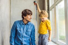 Father and son repair windows together. Repair the house yourself royalty free stock photo