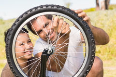 Father and son repairing bike together Royalty Free Stock Image