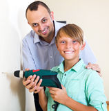 Father and son repairing house Stock Photos
