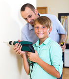 Father and son repairing house Royalty Free Stock Images
