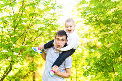 Father and son rest in the summer on the nature.  Stock Photography