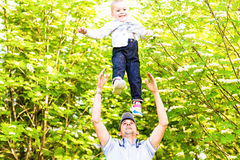 Father and son rest in the summer on the nature.  Royalty Free Stock Photography