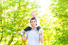 Father and son rest in the summer on the nature.  Stock Photo