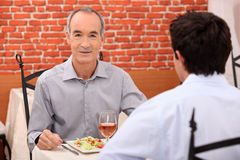 Father and son in restaurant Stock Image