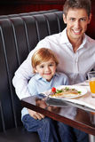Father and son in a restaurant Royalty Free Stock Photo