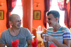 Father and son in a restaurant Stock Photos