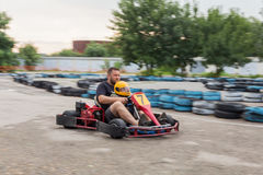 Father and son ride carting Royalty Free Stock Images