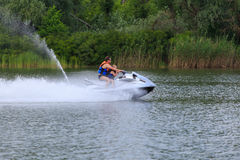 Father and son ride on a jet ski. On the river Don in Rostov-on-Don, June 2016 stock photography