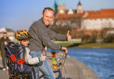 Father with son riding bicycle along waterfront Royalty Free Stock Photos
