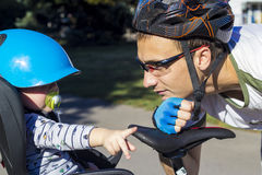 Father and son riding at the bicycle with bike chair Royalty Free Stock Photos