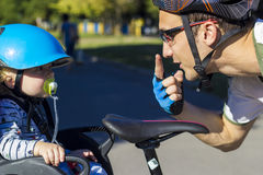 Father and son riding at the bicycle with bike chair Royalty Free Stock Photography