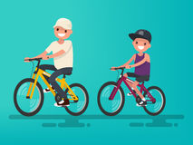 Father and son riding bikes. Vector illustration. Of a flat design Stock Photography