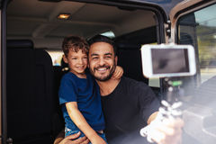 Father and son on road trip taking selfie Royalty Free Stock Photography