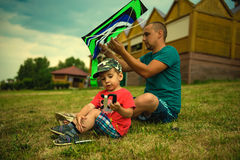 Father and son run into the sky kite Stock Photo
