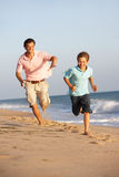 Father And Son Running Along Summer Beach Royalty Free Stock Image