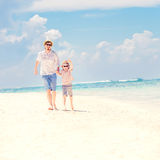 Father with son running barefoot on the sea surf Royalty Free Stock Photography
