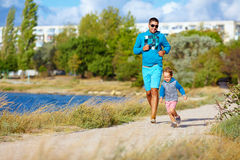 Father and son running in city park, lifestyle. Father and son running in city park, healthy lifestyle Stock Photo