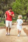 Father and son running in park. Looking at eachother Stock Images