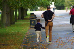 Father and Son Running in Park. Father and Son Running through Regents Park, London Royalty Free Stock Photography