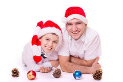 Father and son in Santa's hats Stock Photography