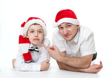 Father and son in Santa's hats Royalty Free Stock Image