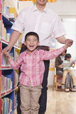 Father And Son In School Classrrom Stock Image