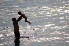 Father and son in the sea Stock Image