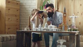 Father and son in search of adventure. Adventure begin right now. Discovering new places. Little child and man with. Binocular and miniature architecture stock video