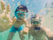 Father and son selfie. Father and son vacation selfie underwater Stock Photos