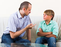 Father and son seriously talking at home Stock Photo
