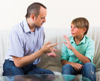 Father and son seriously talking at home Royalty Free Stock Photography