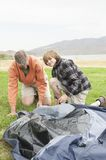 Father And Son Setting Up Tent Stock Photo